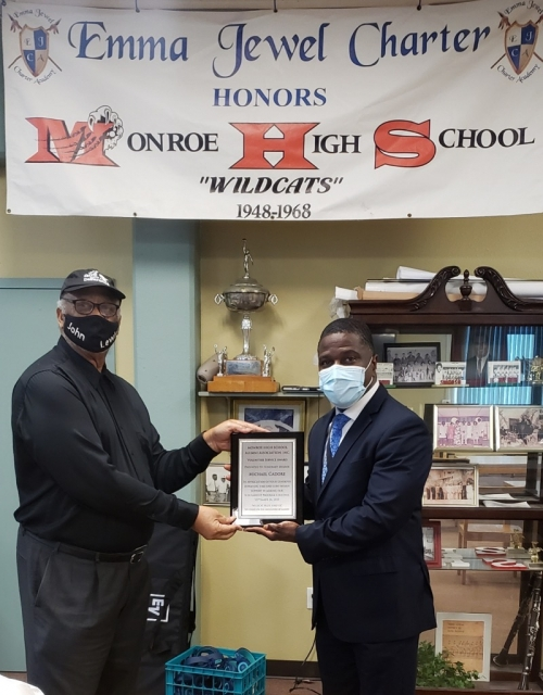 David Jenkins presents plaque to Michael Cadore for his contribution to the MHSAA,Inc 2020 Scholarship Award video